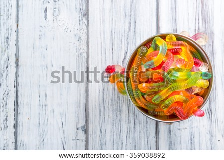 Portion of Gummi Candy (close-up shot) on wooden background - stock photo