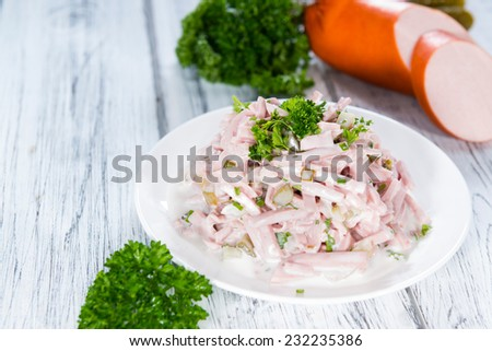 Portion of homemade Meat Salad on wooden background - stock photo