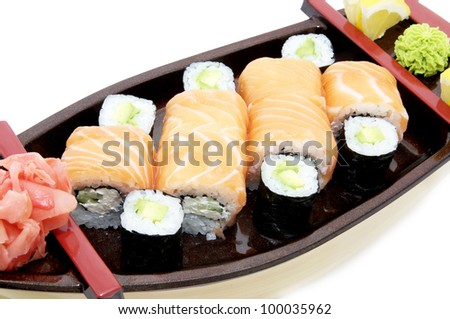 portion of Japanese sushi with fish and rice on a white background