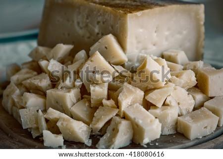 portion of Pecorino cheese. Italian genuine food. Vintage effect - stock photo