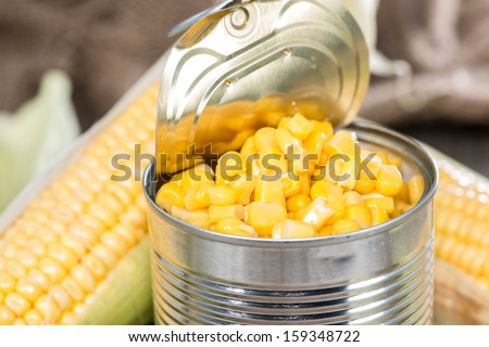 Portion of Preserved Sweetcorn on vintage background - stock photo