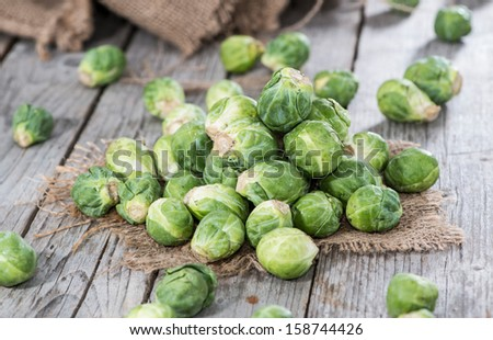 Portion of raw Brussel Sprouts - stock photo
