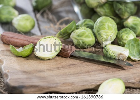 Portion of raw Brussel Sprouts on vintage background - stock photo