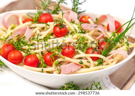 Portion of salad with noodles and herb and tomatoes - stock photo