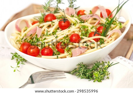 Portion of salad with noodles,herb and tomatoes - stock photo