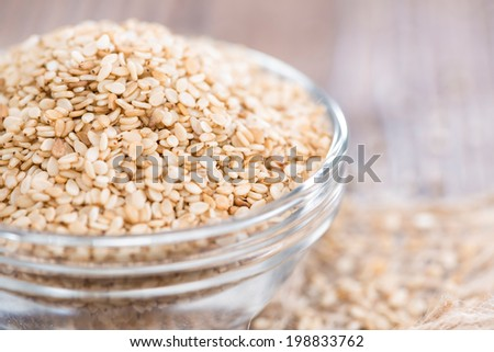 Portion of Sesame Seeds on dark wooden background (close-up shot) - stock photo