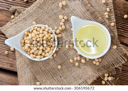 Portion of Soy Oil (close-up shot) on an old wooden table - stock photo