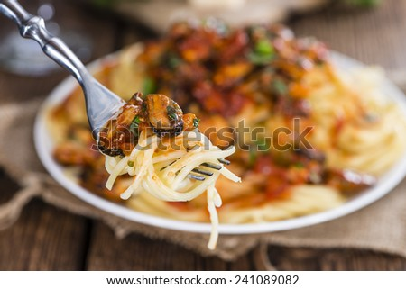 Portion of Spaghetti with Mussels in a fresh made tomato sauce - stock photo