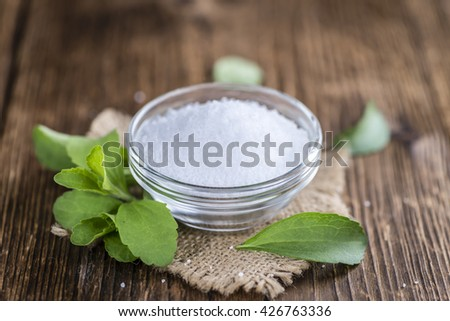 Portion of Stevia Granules (selective focus) on wooden background