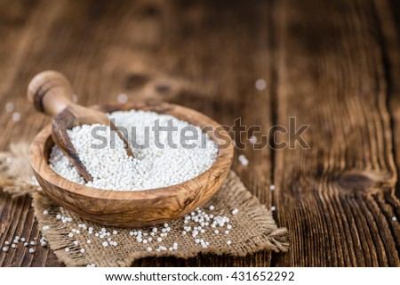 Portion of Tapioca (close-up shot; selective focus) on wooden background