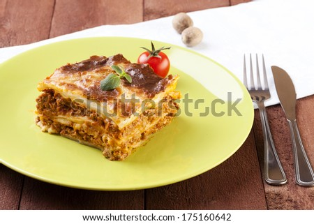 Portion of tasty lasagna on a plate - focus on piece