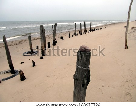portion of the breakwater at the Polish seaside in Kolobrzeg in the winter time bad weather - stock photo