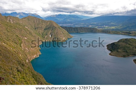 Portion of the Cuicocha lake with its surrounding crater and mountains. - stock photo