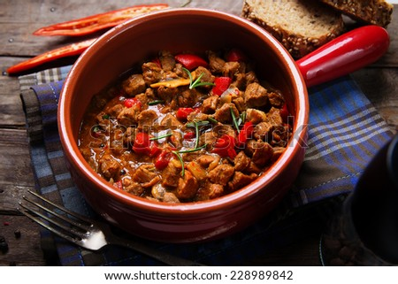 Portion of traditional  beef stew with carrots, red peppers and mushrooms - stock photo