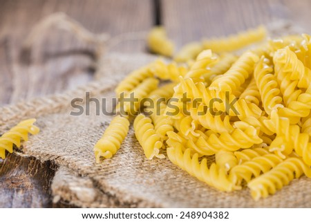 Portion of uncooked Pasta (Fussili, close-up shot) - stock photo