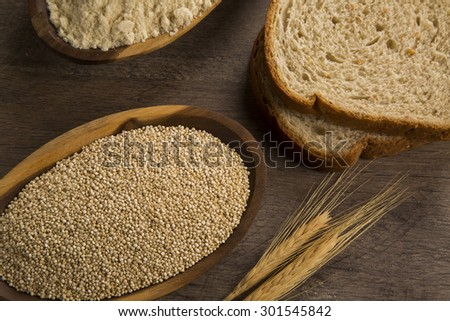 Portion of uncooked Quinoa and whey protein (detailed close-up shot)