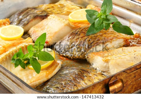portioned carp fillets in a pan