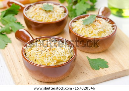 portioned form with baked chicken with mashed cauliflower and cheese, close-up - stock photo
