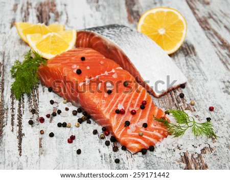 portions of fresh salmon fillet with aromatic herbs, spices  - stock photo