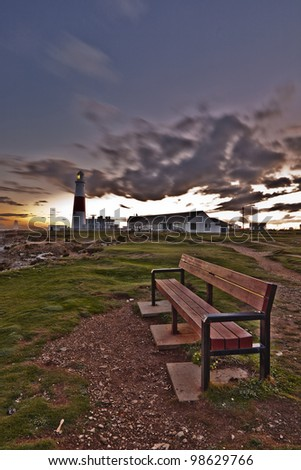 Portland Bill lighthouse during sunset. - stock photo