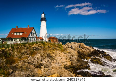 Portland Head Lighthouse and the Atlantic Ocean at Fort Williams Park in Cape Elizabeth, Maine. - stock photo
