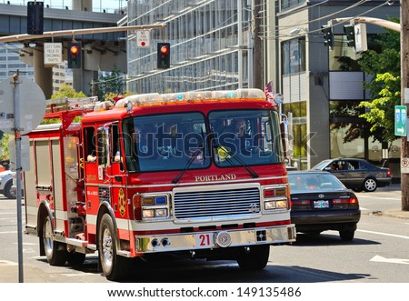 PORTLAND, OR - JULY 14: A fire engine responds to a medical emergency in the industrial areal of Portland Oregon on July 14th, 2013 - stock photo