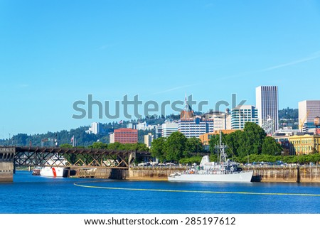 PORTLAND, OR - JUNE 7: Navy and Coast Guard ships on the waterfront of Portland, Oregon during the Rose Festival on June 7, 2015