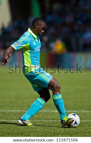 PORTLAND, OR - SEPT 15: Jhon Kennedy Hurtado #34 of the Seattle Sounders moves the ball during soccer game Seattle Sounders vs Portland Timbers, on Sep 15, 2012 at Jeld-Wen Field in Portland, OR. - stock photo