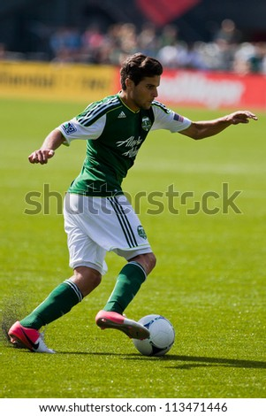 PORTLAND, OR - SEPT 15: The Portland Timbers midfielder Sal Zizzo #7 moves the ball during Seattle Sounders vs. Portland Timbers game, on Sep 15, 2012 at Jeld-Wen Field in Portland, OR. - stock photo