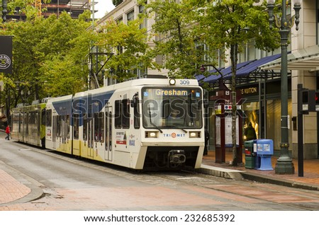 PORTLAND, OR, USA - SEPTEMBER 24, 2014:  MAX, a light rail commuter train sits at a station in the downtown area near the courthouse in Portland Oregon on September 24, 2014 - stock photo