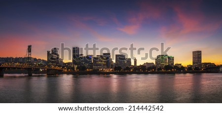 Portland, Oregon city skyline panorama with Hawthorne bridge. Colorful twilight sunset with dramatic sky and light reflection on the Willamette river. - stock photo