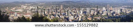 Portland Oregon Cityscape with Scenic Day View of Downtown Buildings Willamette River and Bridges Panorama - stock photo