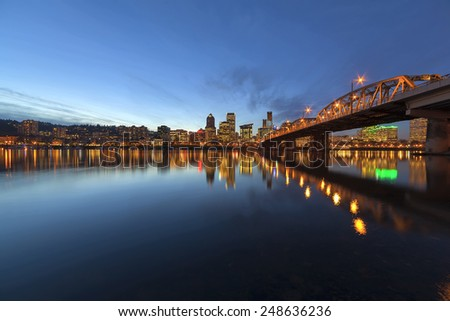 Portland Oregon Downtown City Skyline Along Willamette River by the Hawthorne Bridge at Evening Blue Hour - stock photo