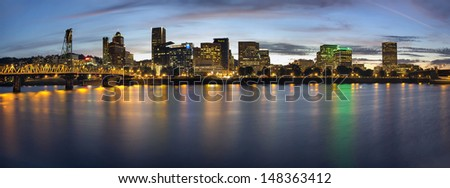 Portland Oregon Downtown Waterfront City Skyline with Hawthorne Bridge at Blue Hour Panorama - stock photo