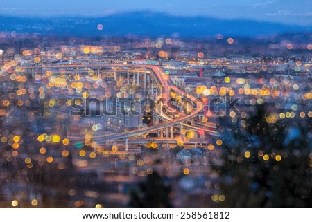 Portland Oregon Marquam Freeway Light Trails with Blurred Out of Focus Bokeh City Lights during Evening Blue Hour - stock photo