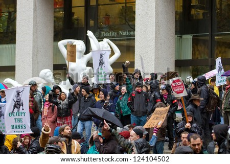 PORTLAND, OREGON - NOV 17: Protesters in Downtown Portland, Oregon during a Occupy Portland Protest Against Banks on the first anniversary of Occupy Wall Street November 17, 2011 - stock photo