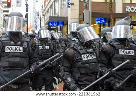 PORTLAND, OREGON - NOVEMBER 17, 2011: Portland Police in Riot Gear in Downtown Portland, Oregon Street during a Occupy Portland Protest Against Banks on the first anniversary of Occupy Wall Street - stock photo