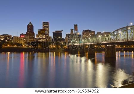 Portland Oregon skyline buildings and bridge at twilight. - stock photo