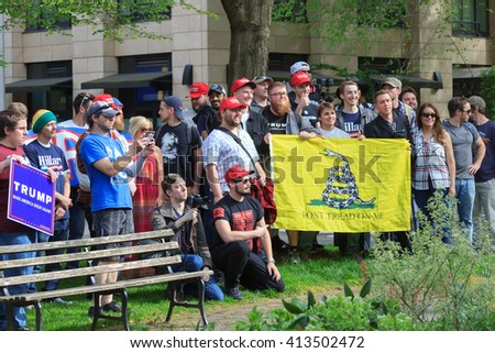 Portland, Oregon, USA - April 16, 2016: Trump supporters gather together to get a photo by Joe Biggs, reporter at InfoWars, during a Trump rally at Portland State University - stock photo