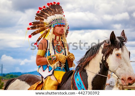 Portland, Oregon, USA - June 11, 2016: The Happy Canyon trail horse, Chinook and Bryson Bronson, his rider in the Grand Floral Parade during Portland Rose Festival 2016.
