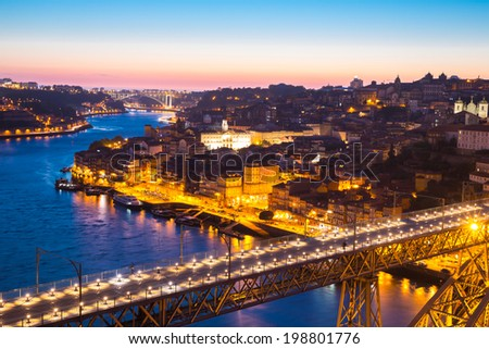 Porto Cityscape Portugal at dusk with Dom Luiz bridge - stock photo
