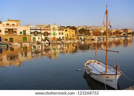 Porto Colom typical seaside village in Majorca (Spain) at sunset - stock photo