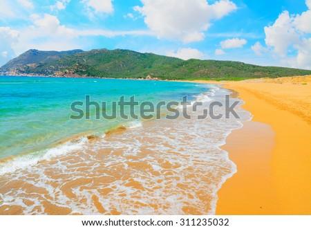 Porto Ferro beach under white clouds, Sardinia - stock photo