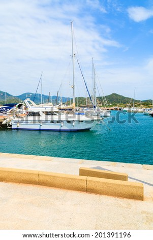 PORTO GIUNCO HARBOUR, SARDINIA - MAY 25, 2014: view of Porto Giunco touristic port with sailboats and yachts mooring, Sardinia island, Italy. Many tourists visit Sardinia island in summer time.