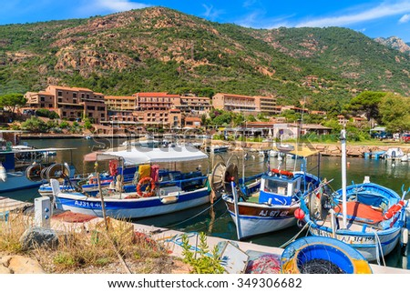 PORTO HARBOUR, CORSICA ISLAND - JUN 27, 2015: colourful fishing boats mooring in Porto village to the west of Corsica, ideally placed for exploring this beautiful region of Corsica island.