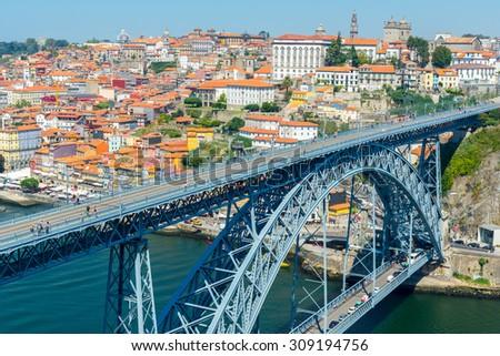 Porto historic city centre with Ponte Luis I Bridge over Douro river from lookout of Mosteiro da Serra do Pilar in Portugal - stock photo
