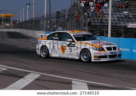 PORTO - JULY 8: F. Porteiro of Spain in his BMW participates in the FIA WORLD TOURING CAR CHAMPIONSHIP (WTCC) on July 8, 2007 in Porto, Portugal. Andy Priaulx emerged 2007 WTCC Drivers' Champion. - stock photo