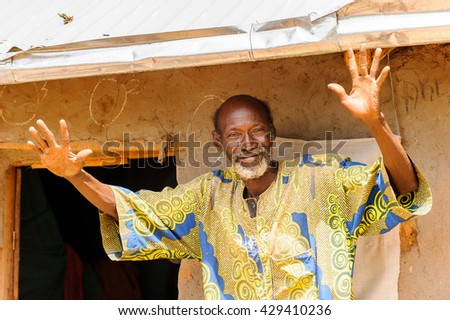 PORTO-NOVO, BENIN - MAR 8, 2012: Portrait of the unidentified funny Beninese man waves hands and smiles. People of Benin suffer of poverty due to the difficult economic situation.