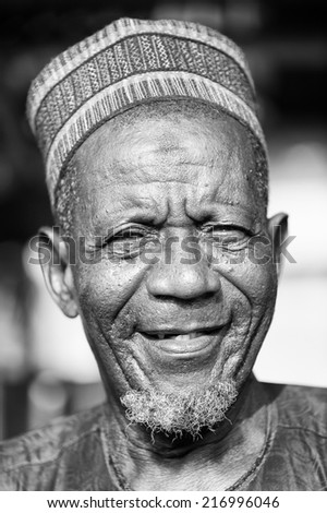 PORTO-NOVO, BENIN - MAR 8, 2012: Portrait of Unidentified Beninese old man smiling in a typical hat. People of Benin suffer of poverty due to the difficult economic situation.