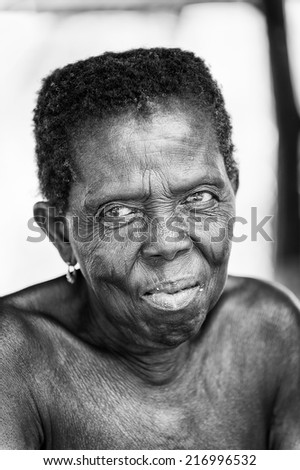 PORTO-NOVO, BENIN - MAR 8, 2012: Portrait of unidentified Beninese old woman. People of Benin suffer of poverty due to the difficult economic situation.